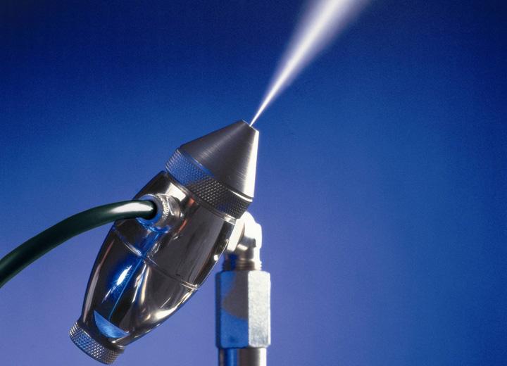 Droppfri fuktning med hjälp av tryckluft