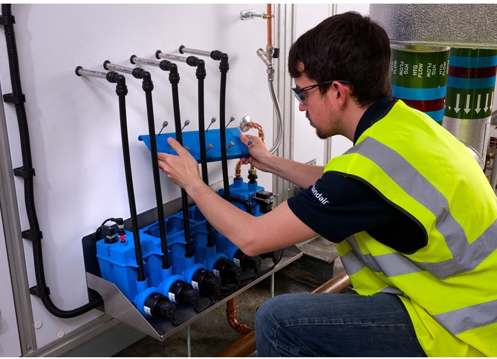 Technician fixing multi-stage pump system on humidifier