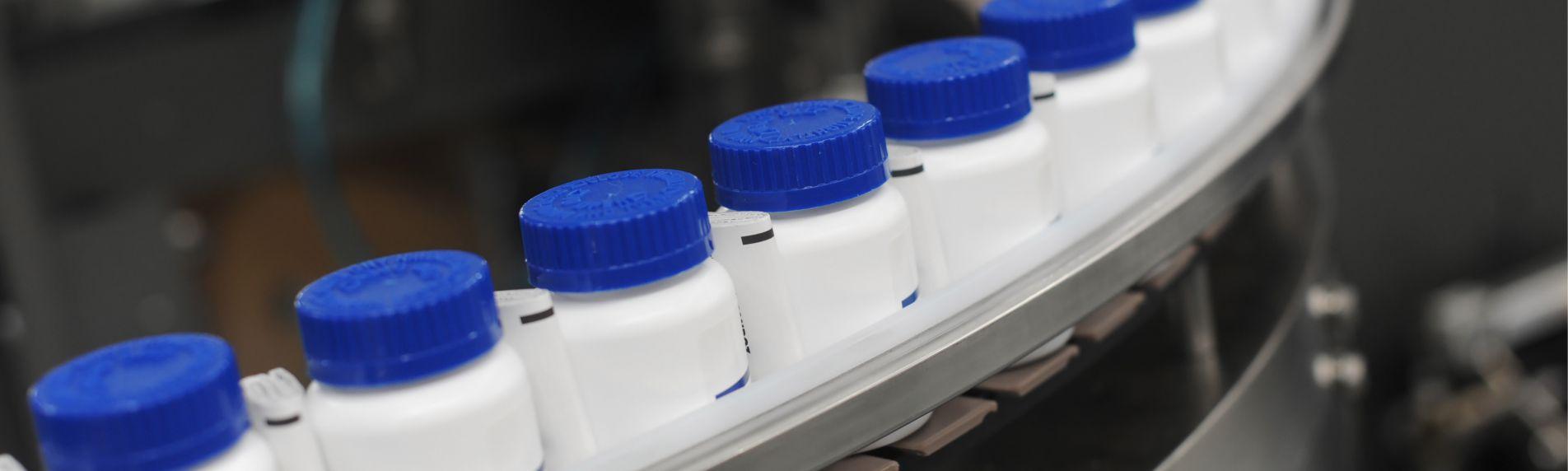 Prescription bottles on a factory line