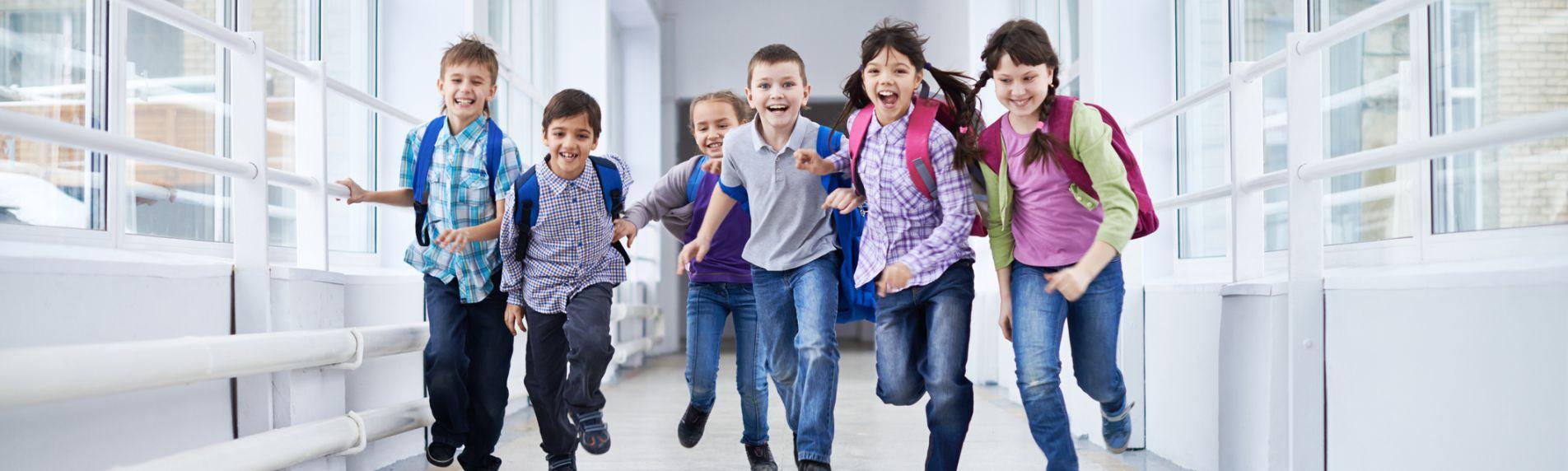 School aged children running down hall