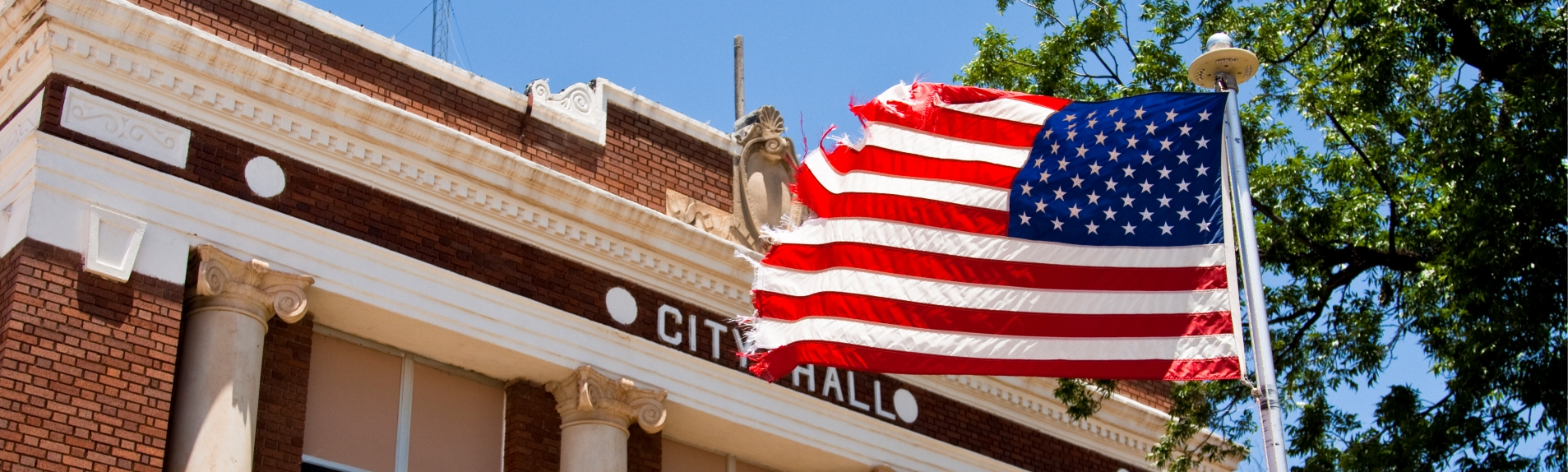 American flag displayed outside a city hall