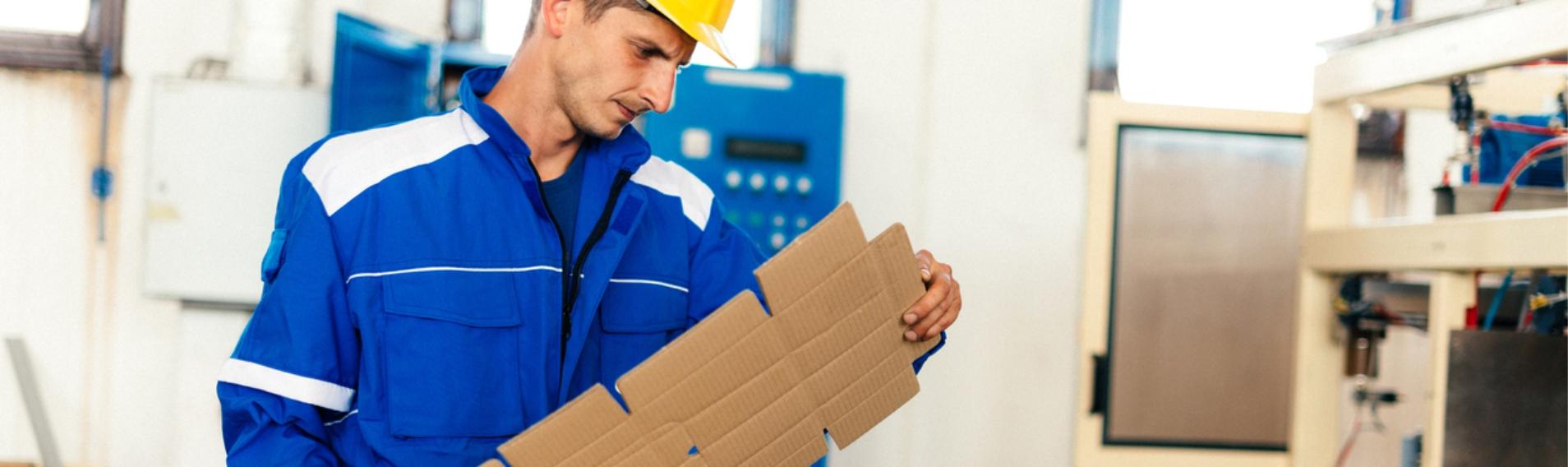 Man holding preformed cardboard packaging
