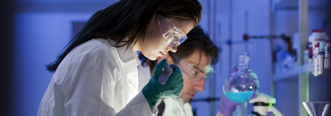 Two laboratory technicians conducting research