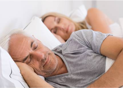 Couple sleeping through the night