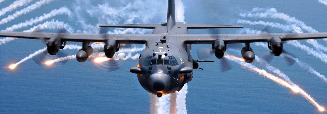 Lockheed AC-130 gunship activating flares