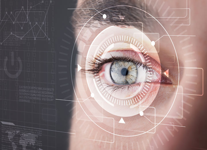 Human eye surrounded by computer related graphics and imagery