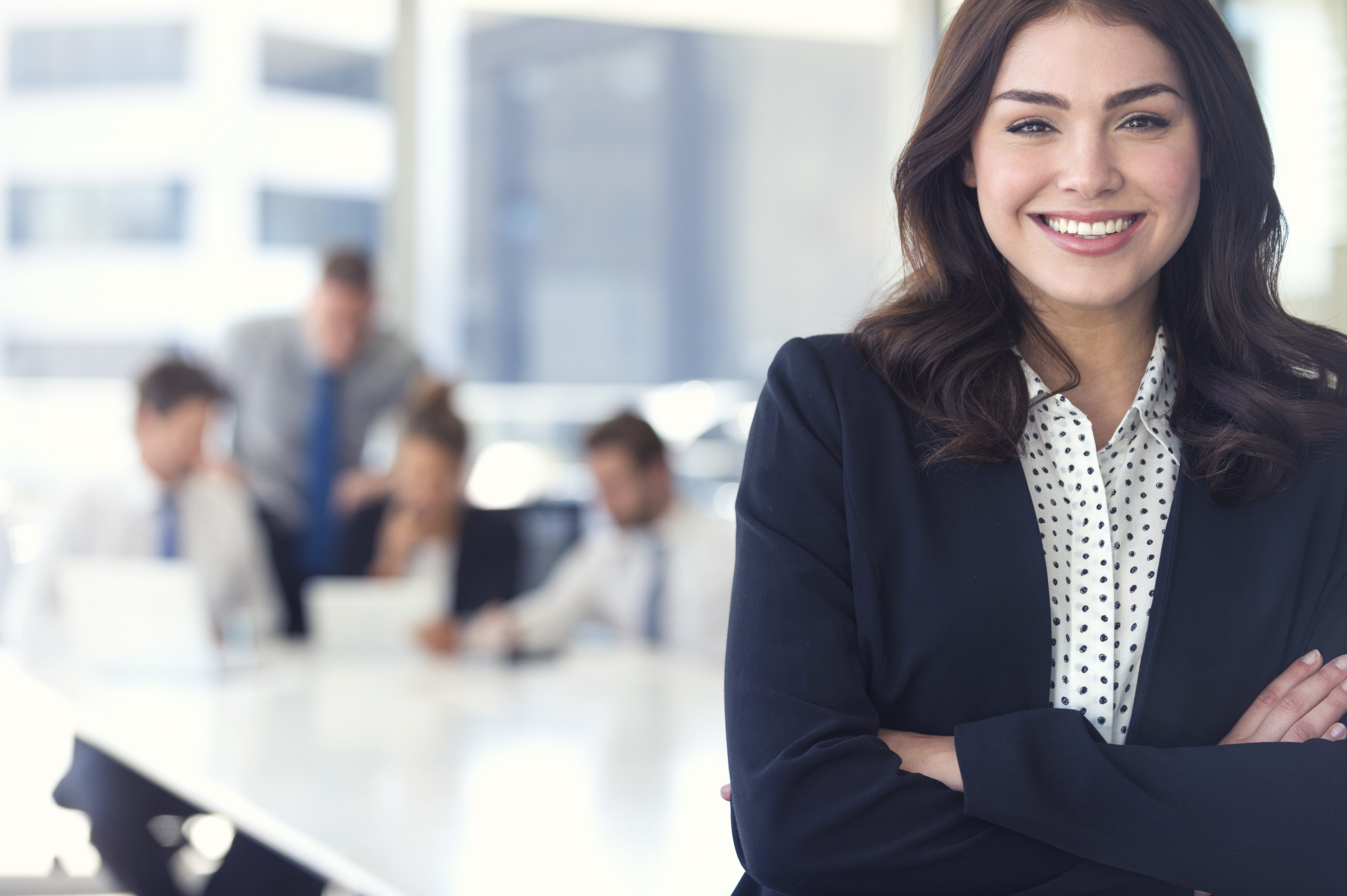 Woman in office boardroom smiling