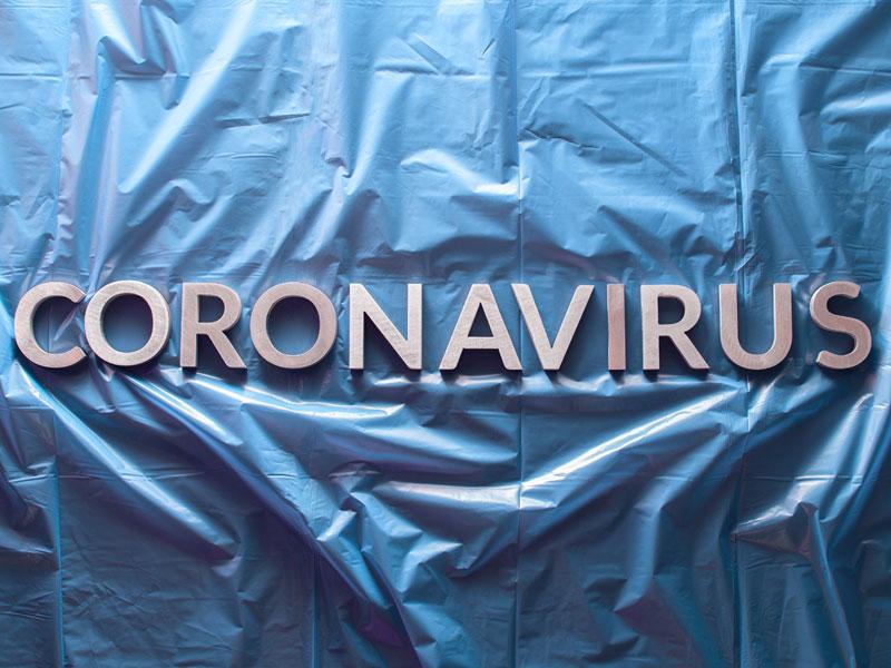 Coronavirus written across blue tarp