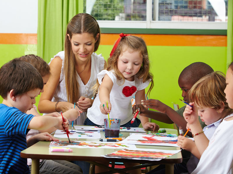 Children painting at table
