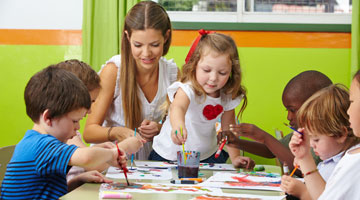 children painting in classroom