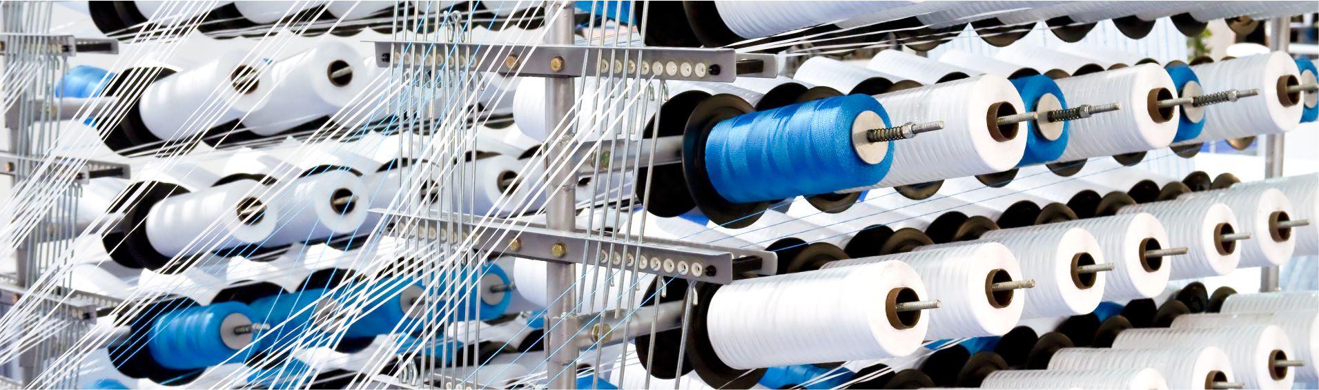 Textile manufacturing spool machine