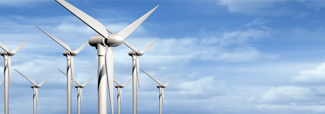 Wind turbines with cloudy backdrop