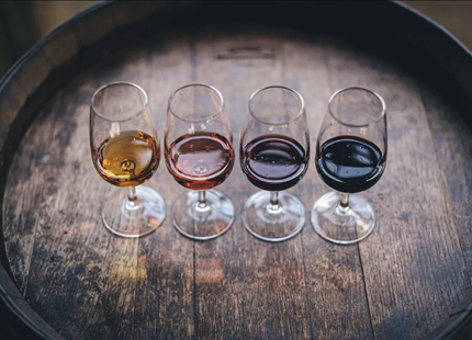 Wine samples on a wooden barrel